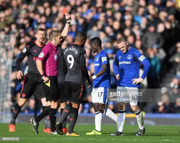 Idrissa Gueye of Everton is is shown his second yellow card of the game by referee Craig Pawson during the Premier League match between Everton and...