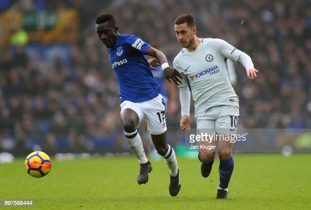 Idrissa Gueye of Everton runs with the ball under pressure from Eden Hazard of Chelsea during the Premier League match between Everton and Chelsea at...