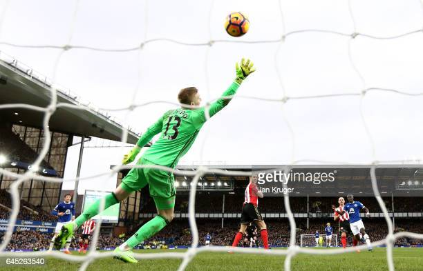 Idrissa Gueye of Everton scores his sides first goal past Jordan Pickford of Sunderland during the Premier League match between Everton and...