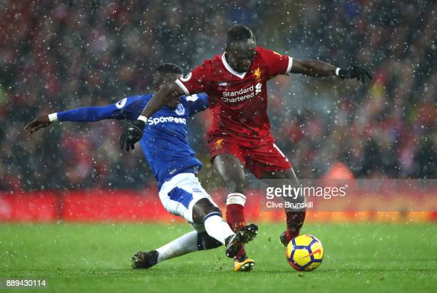 Idrissa Gueye of Everton tackles Sadio Mane of Liverpool during the Premier League match between Liverpool and Everton at Anfield on December 10 2017...