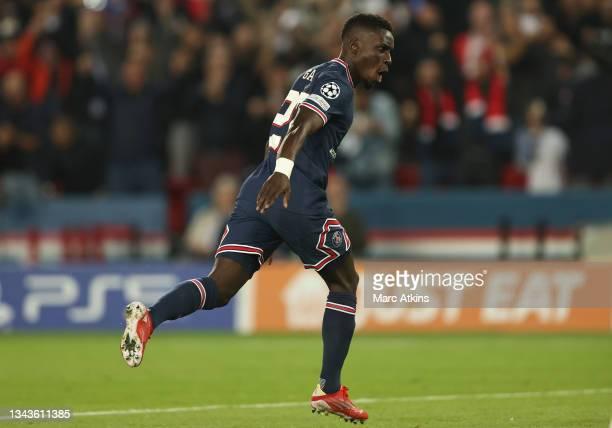 Idrissa Gueye of Paris Saint-Germain celebrates after scoring his team's first goal during the UEFA Champions League group A match between Paris...