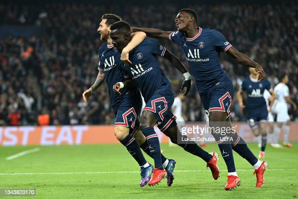 Idrissa Gueye of Paris Saint-Germain celebrates with team mates Lionel Messi and Nuno Mendes after scoring their sides first goal during the UEFA...