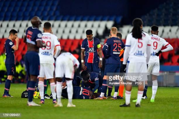 Idrissa Gueye of Paris Saint-Germain checks on teammate Neymar Jr after a tackle from Thiago Mendes of Olympique Lyonnais during the Ligue 1 match...