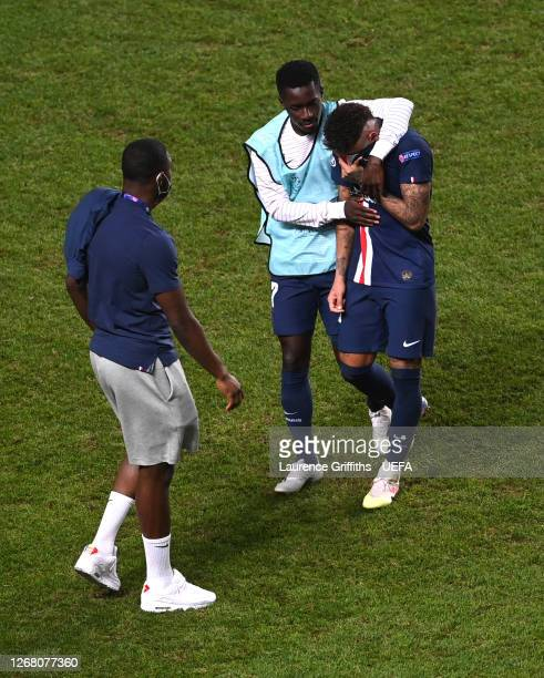 Idrissa Gueye of Paris SaintGermain consoles teammate Neymar of Paris SaintGermain following their team's defeat in the UEFA Champions League Final...