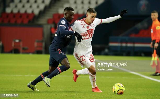 Idrissa Gueye of Paris Saint-Germain in action with Romain Faivre of Stade Brest during the Ligue 1 match between Paris Saint-Germain and Stade Brest...