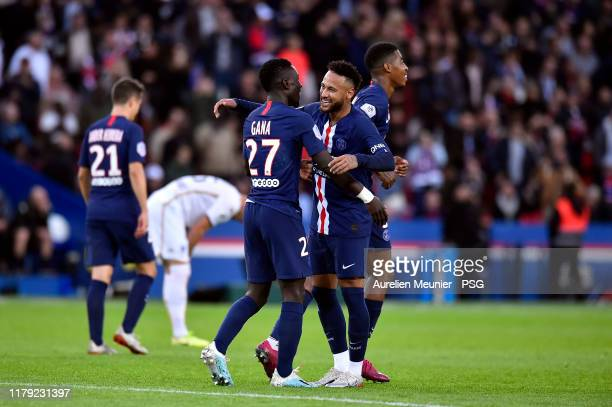 Idrissa Gueye of Paris SaintGermain is congratulated by teammate Neymar Jr after scoring during the Ligue 1 match between Paris SaintGermain and...