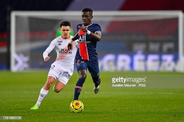Idrissa Gueye of Paris Saint-Germain runs with the ball during the Ligue 1 match between Paris Saint-Germain and FC Lorient at Parc des Princes on...