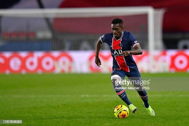 Idrissa Gueye of Paris Saint-Germain runs with the ball during the Ligue 1 match between Paris Saint-Germain and RC Strasbourg at Parc des Princes on...