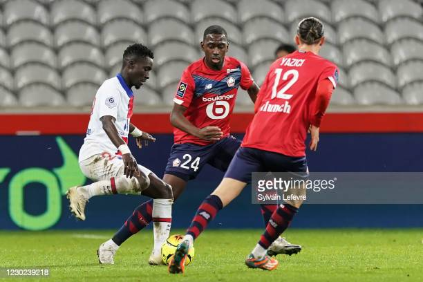 Idrissa Gueye of Paris SG competes for the ball with Boubakary Soumare of Lille OSC and Yusuf Yazici of Lille OSC during the Ligue 1 match between...