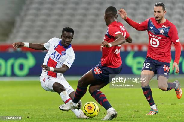 Idrissa Gueye of Paris SG is challenged by Boubakary Soumare of Lille OSC during the Ligue 1 match between Lille OSC and Paris Saint-Germain at Stade...