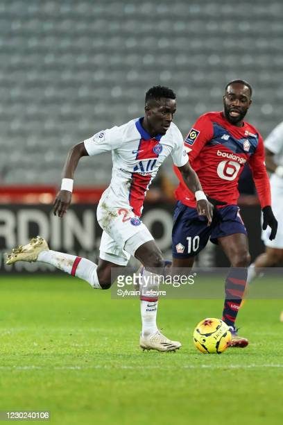 Idrissa Gueye of Paris SG is challenged by Jonathan Ikone of Lille OSC during the Ligue 1 match between Lille OSC and Paris Saint-Germain at Stade...