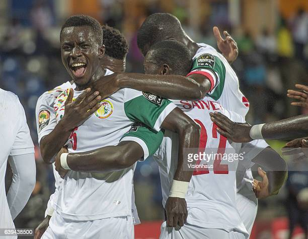 Idrissa Gueye of Senegal celebrates Henri Saivet's goal during the Group B match between Senegal and Zimbabwe at Stade Franceville on January 19 2017...