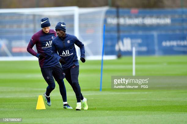 Idrissa Gueye warms up during a Paris Saint-Germain training session at Ooredoo Center on January 21, 2021 in Paris, France.