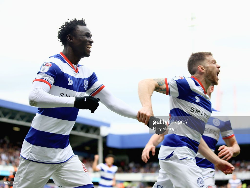 Idrissa Sylla of Queens Park Rangers celebrates scoring his team's equiliser with teammate Jamie Mackie during the Sky Bet Championship match between Queens Park Rangers and Sheffield Wednesday at Loftus Road on April 17, 2017 in London, England.