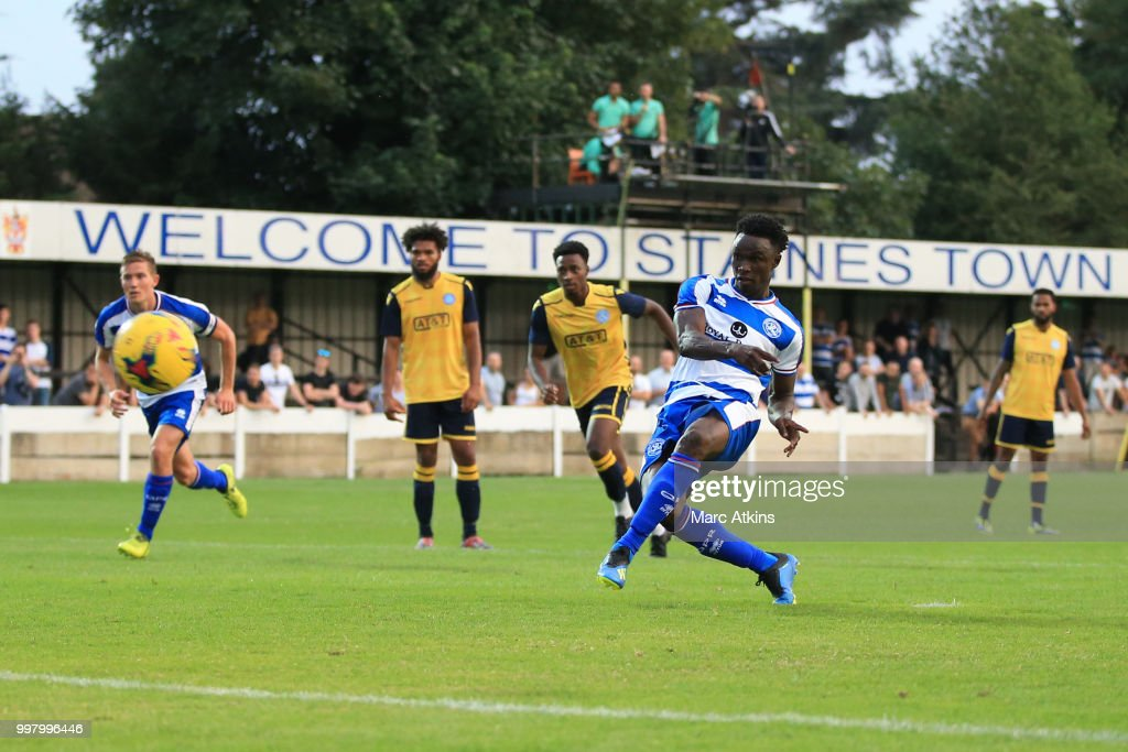 Idrissa Sylla of Queens Park Rangers scores a goal from the penalty spot during the Pre-Season Friendly between Staines Town and Queens Park Rangers at Wheatsheaf Park on July 13, 2018 in Staines, England.