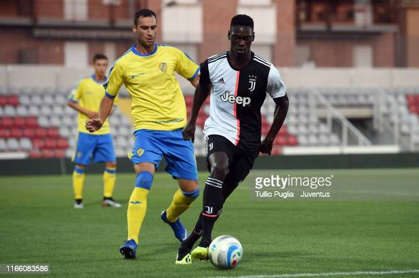 Idrissa Toure of Juventus U23 holds off the challenge by Michel Panatti of Pergolettese during the Coppa Italia Serie C match between Juventus U23...