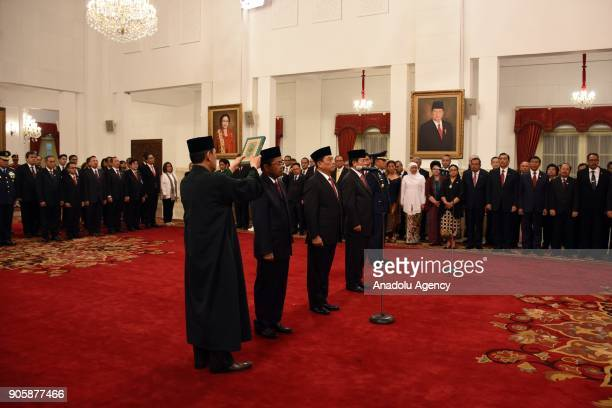 Idrus Marham Moeldoko Agum Gumelar and Yuyu Sutisna take their oath during an inauguration ceremony at the State Palace in Jakarta Indonesia on...