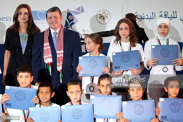 Jordan's King Abdullah and his wife Queen Rania along with their daughters Princess Iman and Princess Salma pose for a photograph with school...