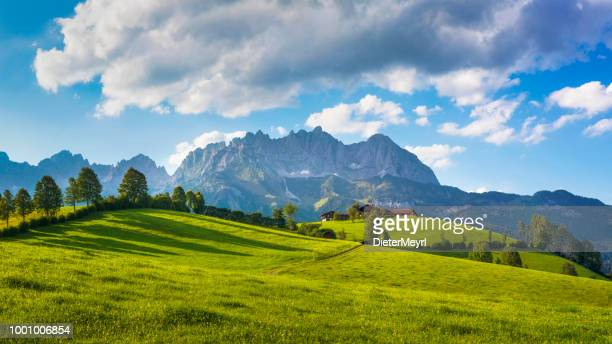 idyllic alpine scenery, farmhouse in front of wilder kaiser, austria, tirol  - kaiser mountains - austria stock photos and pictures