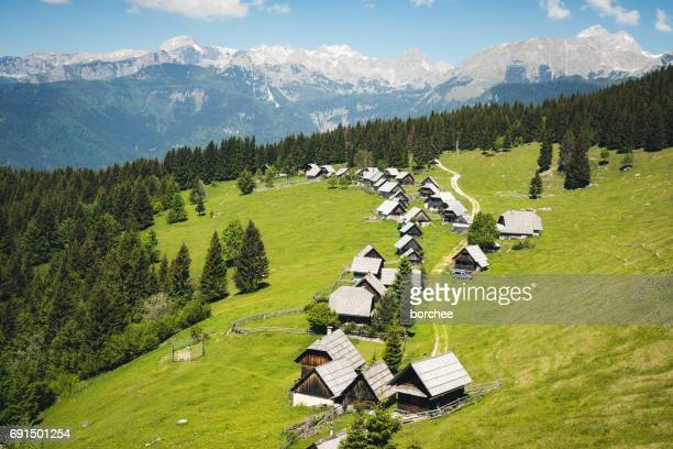 idyllic alpine village in slovenia - pokljuka stock photos and pictures