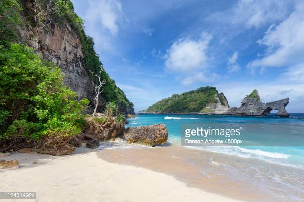 idyllic atuh beach - regency style stock photos and pictures