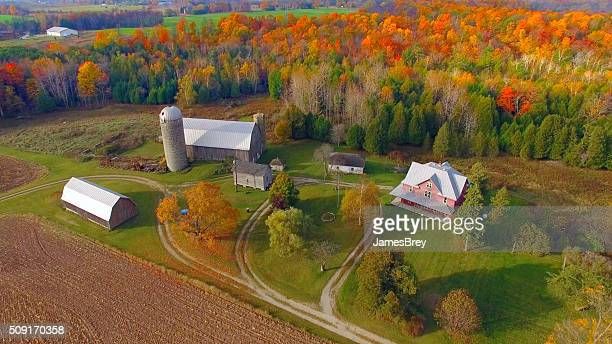 Idyllic autumn rural landscape with fiery colors