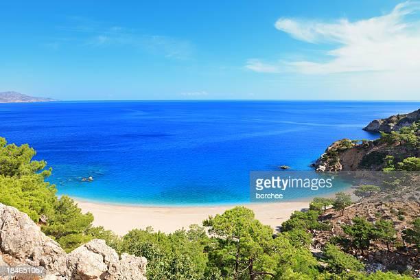 idyllic beach on karpathos island - dodecanese islands stock photos and pictures