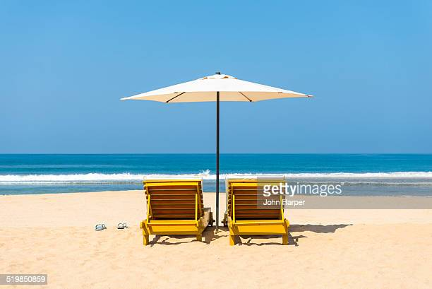idyllic beach scene - outdoor chair stock pictures, royalty-free photos & images