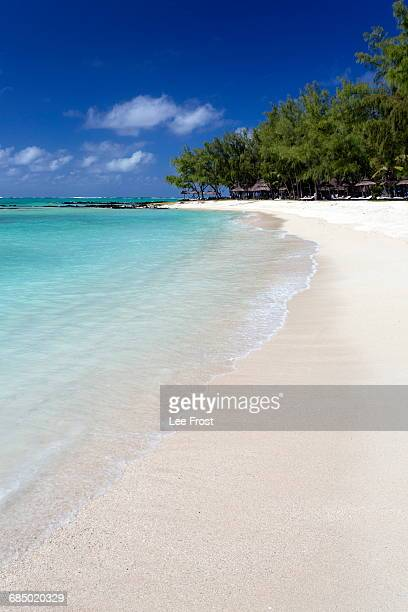Idyllic beach scene with blue sky, aquamarine sea and soft sand, Ile Aux Cerfs, Mauritius, Indian Ocean, Africa