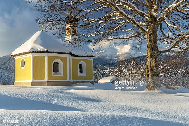 idyllic chapel in bavarian winter landscapes - krün stock pictures, royalty-free photos & images