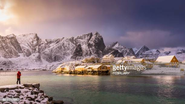 idyllic coastal village at reine in winter, norway - remote location stock pictures, royalty-free photos & images