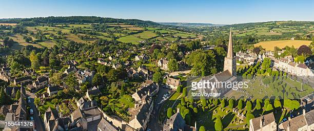 Idyllic Cotswold village church homes country aerial panorama