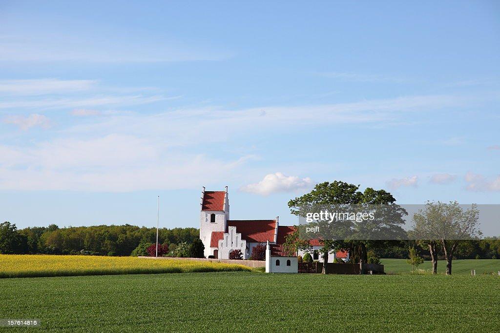 Idyllic country side parish church in evening sun : Stock Photo