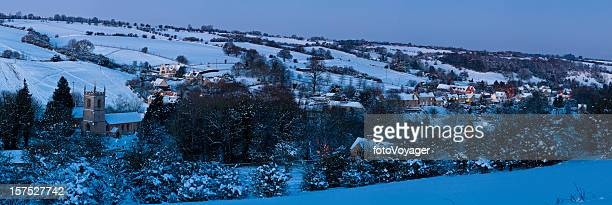idyllic country village snow landscape blue dusk warm lights cotswolds - christmas scenes stock photos and pictures