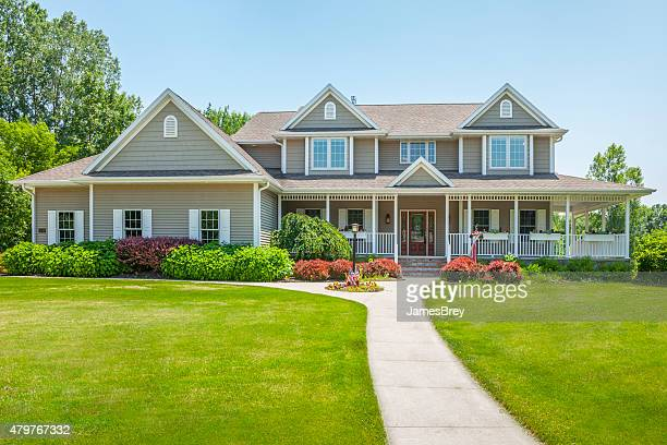 idyllic home with covered porch - roof stock photos and pictures