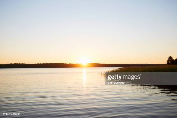 idyllic lake during sunset in summer - mecklenburg vorpommern stock pictures, royalty-free photos & images