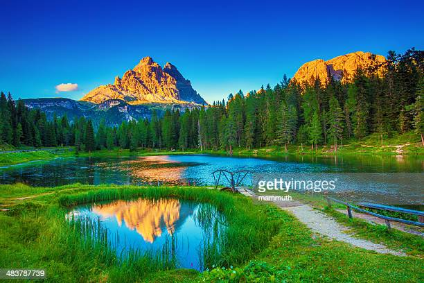 idyllic lake in the mountains - veneto stock pictures, royalty-free photos & images