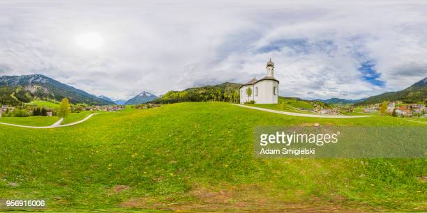 idyllic landscape with small church in the alps (360-degree panorama) - high dynamic range imaging stock photos and pictures
