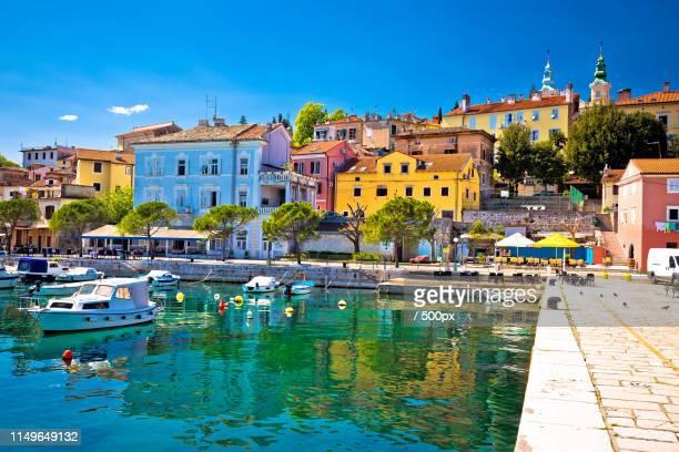 idyllic mediterranean waterfront in volosko village - bucht stock-fotos und bilder