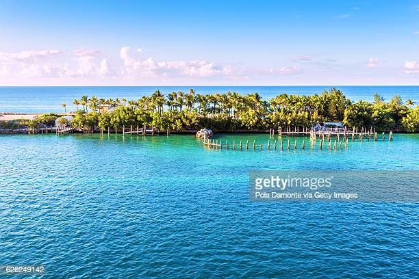 idyllic nassau beach at the bahamas in the caribbean. - nassau stock photos and pictures