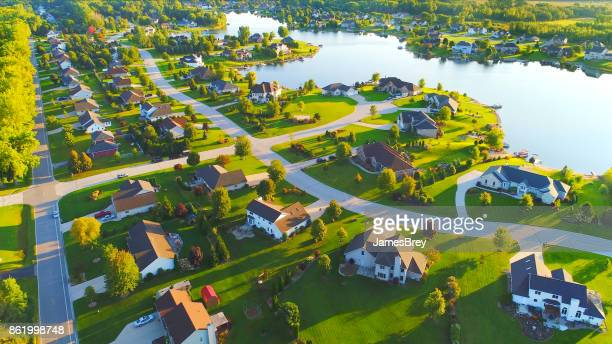 idyllic neighborhood on lakefront at dawn. - wisconsin stock pictures, royalty-free photos & images