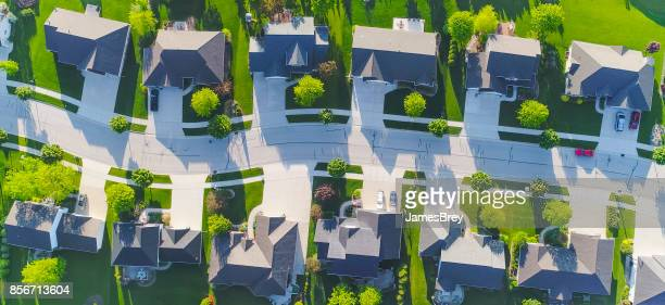 idyllic neighborhood street, aerial view - roof stock photos and pictures