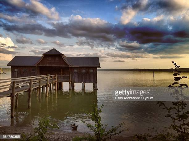 Idyllic Of Boathouse In Ammersee Against Sky