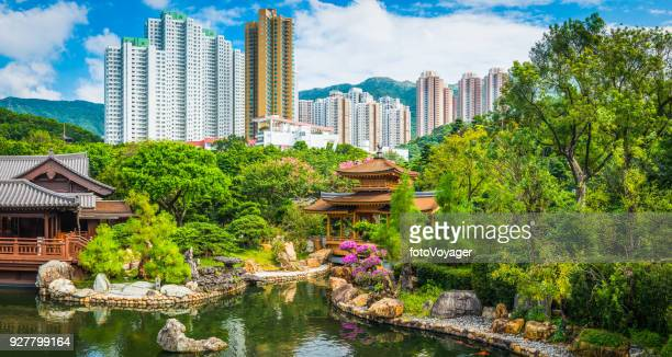 idyllic park tradtional tea house pagodas skyscrapers hong kong china - kowloon peninsula stock pictures, royalty-free photos & images