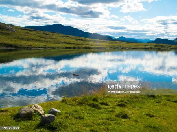 Idyllic peaceful lake with mountains in the horizon