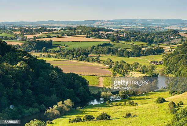 Idyllic river valley country villages summer fields