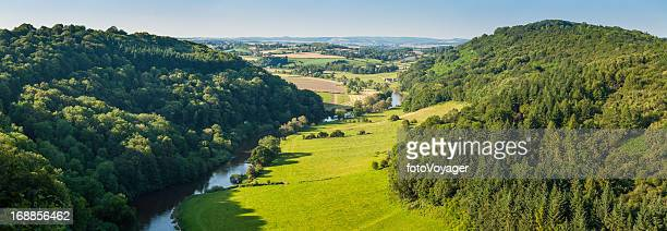 Idyllic river valley green patchwork landscape farms forests