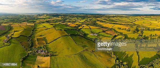 Idyllic rural landscape fields farms aerial panorama