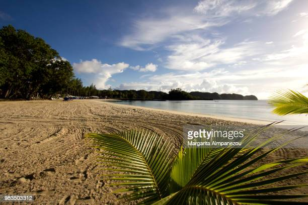 Idyllic sandy beach at the tropical island of Palau in the Pacific Ocean