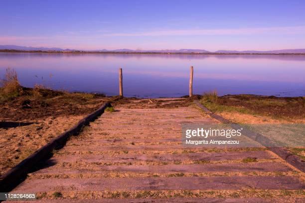 Idyllic shot of a wooden platform leading to a calm lake